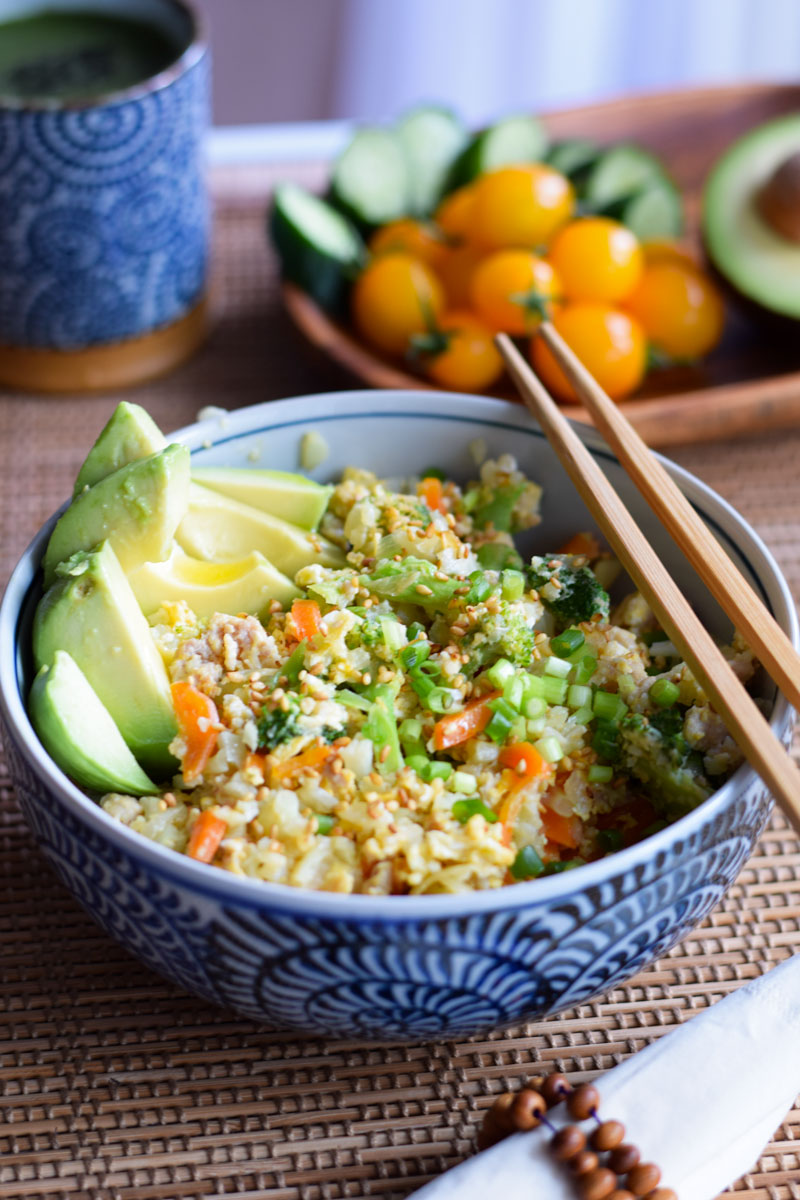 chicken cauliflower fried rice with avocado side