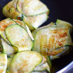 cooking zucchini recipe- wrapped gyoza in fry pan