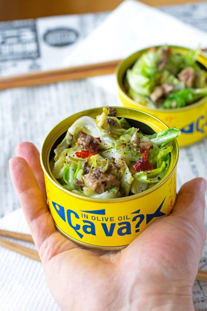 Holding Japanese Italian-style appetizer in a can